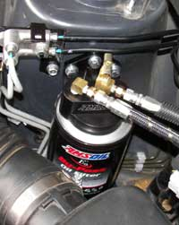 Amsoil's BMK-21 attached to Subaru's engine compartment.
